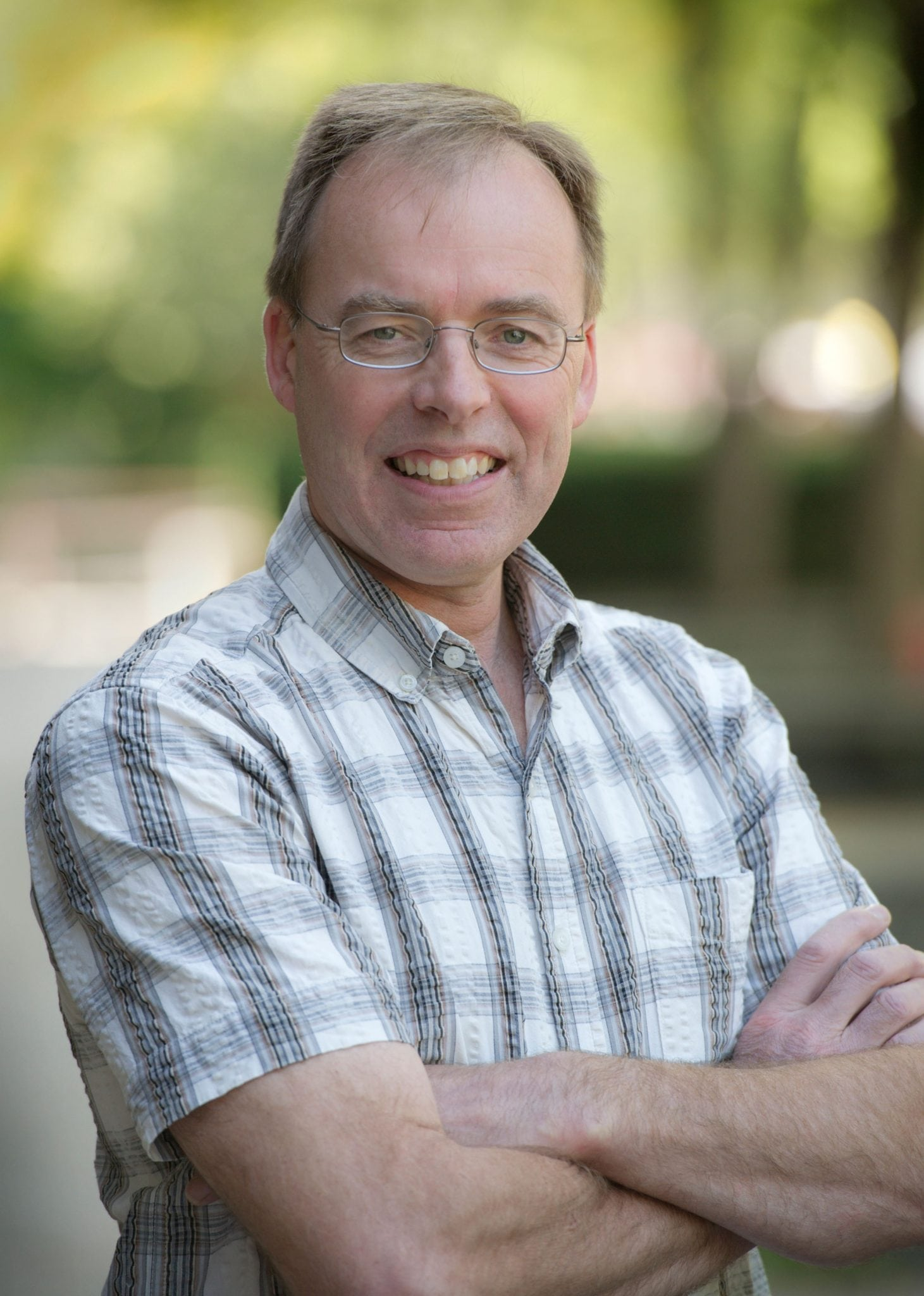Photo of Prof. Bill Deen smiling with arms crossed and wearing a plaid shirt