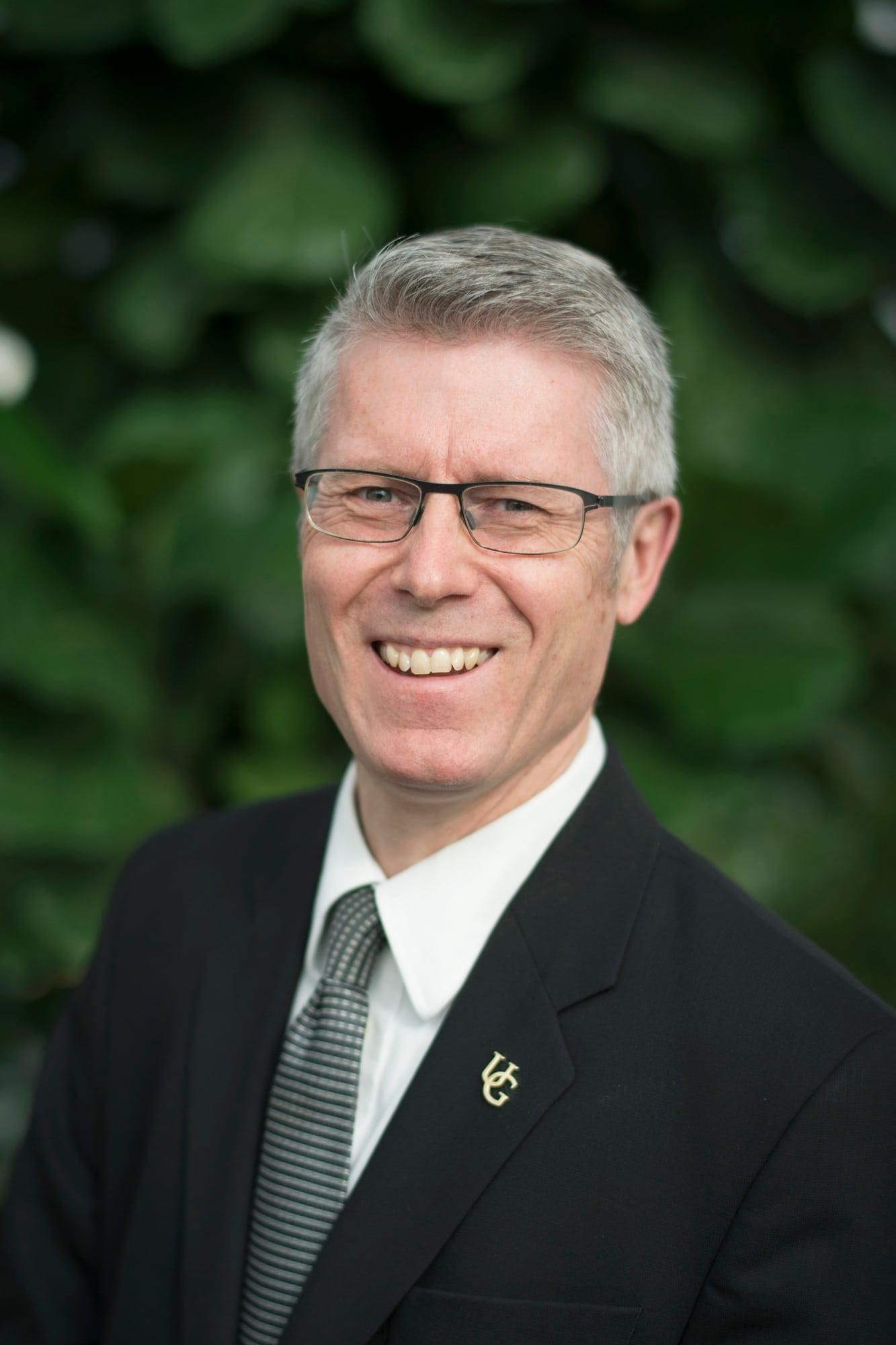 Malcolm Campbell smiling at camera