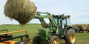 Tractor lifting hay