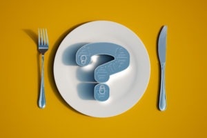 Image of can-shaped question mark on empty plate